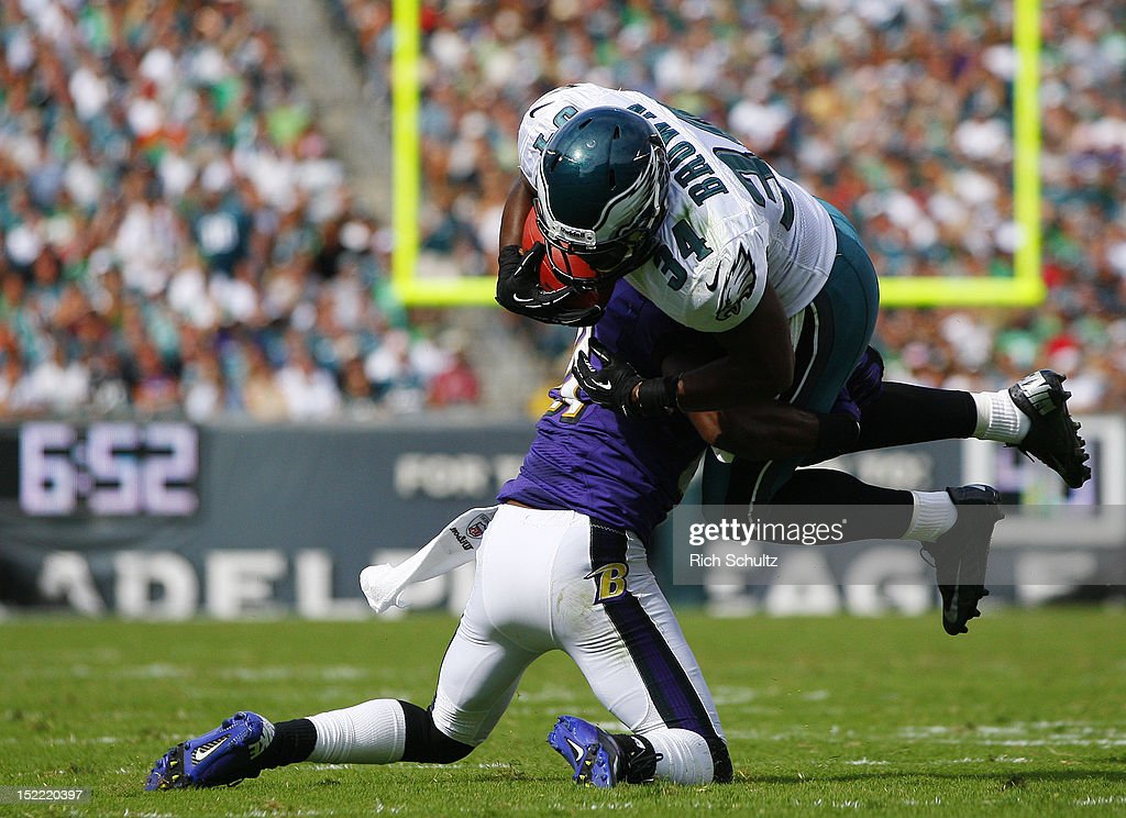 Running back Bryce Brown #34 of the Philadelphia Eagles is tackled by <a gi-track='captionPersonalityLinkClicked' href=/galleries/search?phrase=Lardarius+Webb&family=editorial&specificpeople=5735454 ng-click='$event.stopPropagation()'>Lardarius Webb</a> #21of the Baltimore Ravens during a game at Lincoln Financial Field on September 16, 2012 in Philadelphia, Pennsylvania. The Eagles defeated the Ravens 24-23.