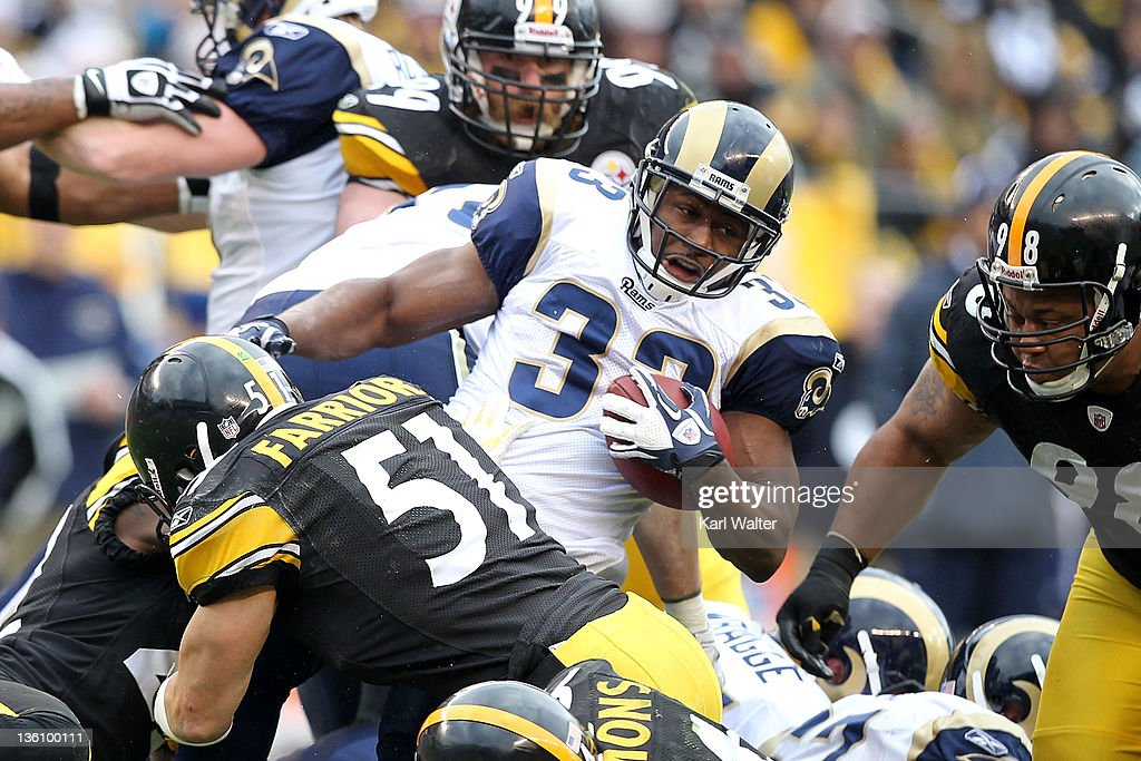 Running back Cadillac Williams #33 of the St. Louis Rams is tackled by lineback James Farrior #51 of the Pittsburgh Steelers during the game at Heinz Field on December 24, 2011 in Pittsburgh, Pennsylvania.