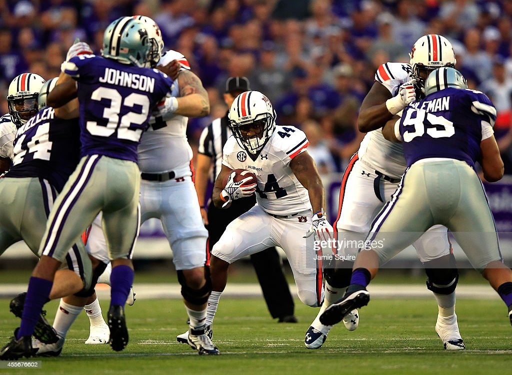 Running back Cameron ArtisPayne of the Auburn Tigers carries the ball during the game against the Kansas State Wildcats at Bill Snyder Family...