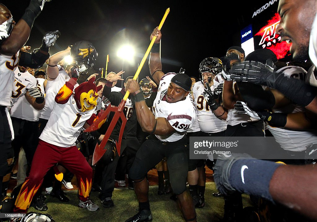 Running back Cameron Marshall #6 of the Arizona State Sun Devils spikes the fork into the grass in celebration after defeating the Arizona Wildcats 41-34 in the college football game at Arizona Stadium on November 23, 2012 in Tucson, Arizona.