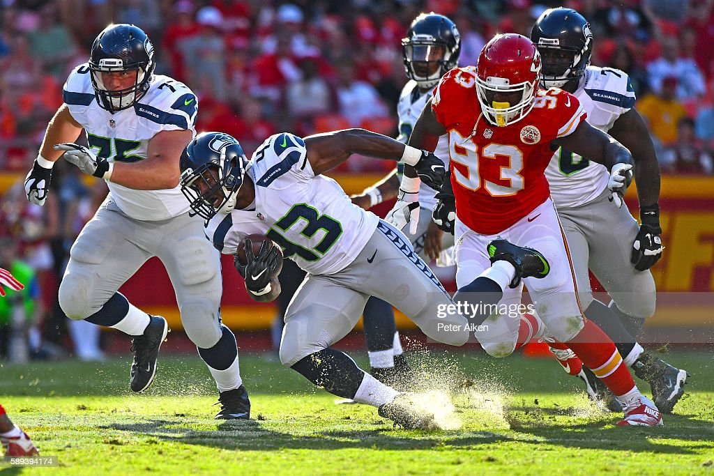 Running back Cameron Marshall #43 of the Seattle Seahawks rushes past defensive linemen David King #93 of the Kansas City Chiefs during the second half on August 13, 2016 at Arrowhead Stadium in Kansas City, Missouri.