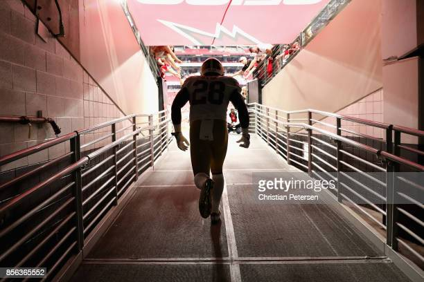 Running back Carlos Hyde of the San Francisco 49ers runs onto the field for warm ups before the start of the NFL game against the Arizona Cardinals...