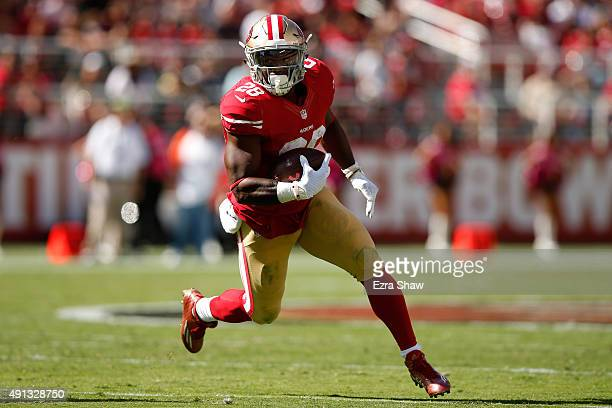 Running back Carlos Hyde of the San Francisco 49ers rushes against the Green Bay Packers during their NFL game at Levi's Stadium on October 4 2015 in...