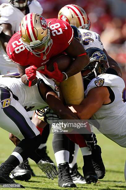 Running back Carlos Hyde of the San Francisco 49ers rushes with the ball against the Baltimore Ravens during their NFL game at Levi's Stadium on...