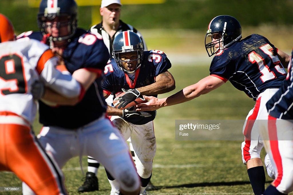 Running Back Carrying Ball