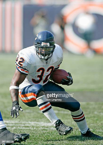 Running back Cedric Benson of the Chicago Bears carries the ball against the Detroit Lions on September 18 2005 at Soldier Field in Chicago Illinois...