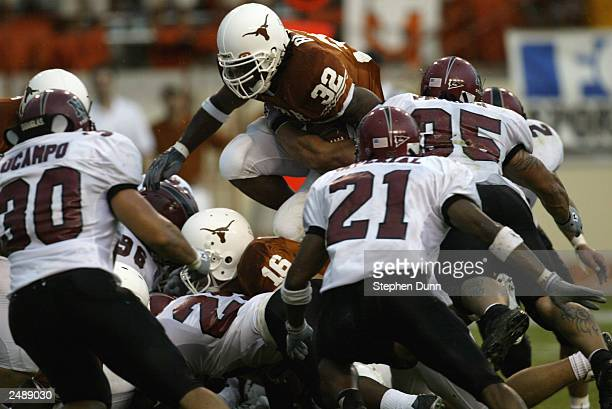 Running back Cedric Benson of the University of Texas at Austin Longhorns leaps over the New Mexico State University Aggies during the game Texas...