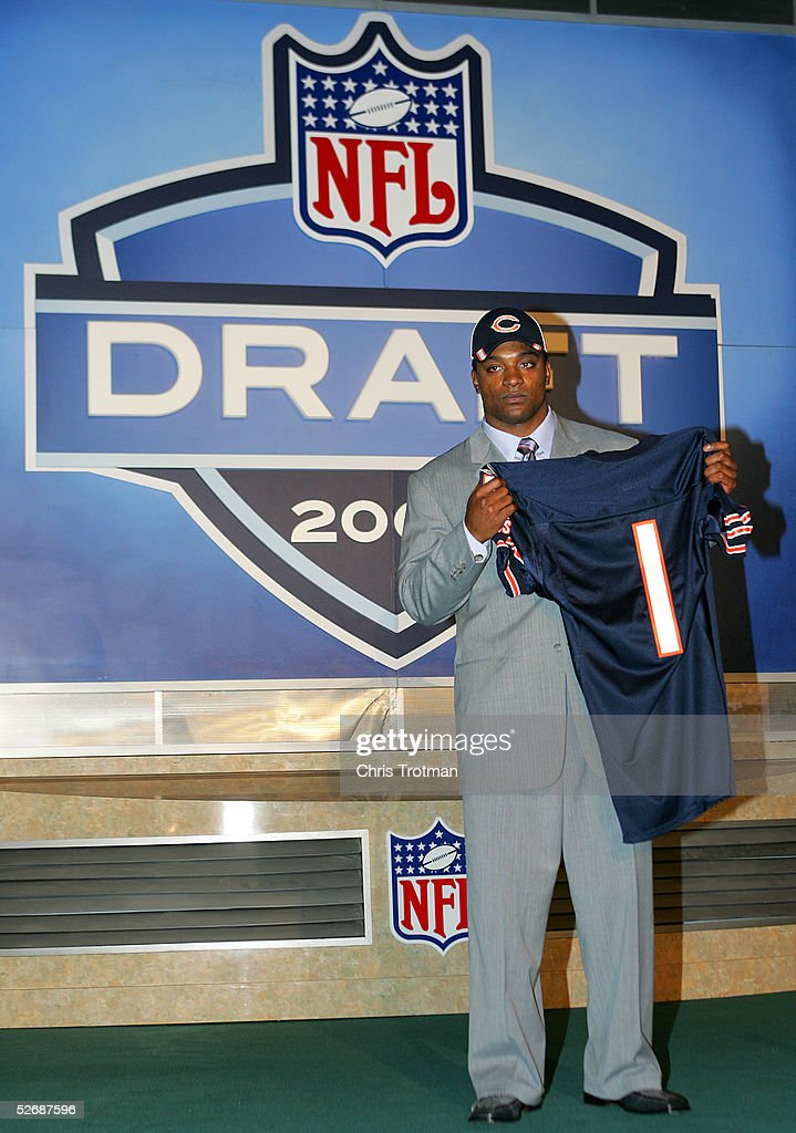 Running back Cedric Benson poses with his jersey after being drafted fourth overall by the Chicago Bears during the 70th NFL Draft on April 23 2005...