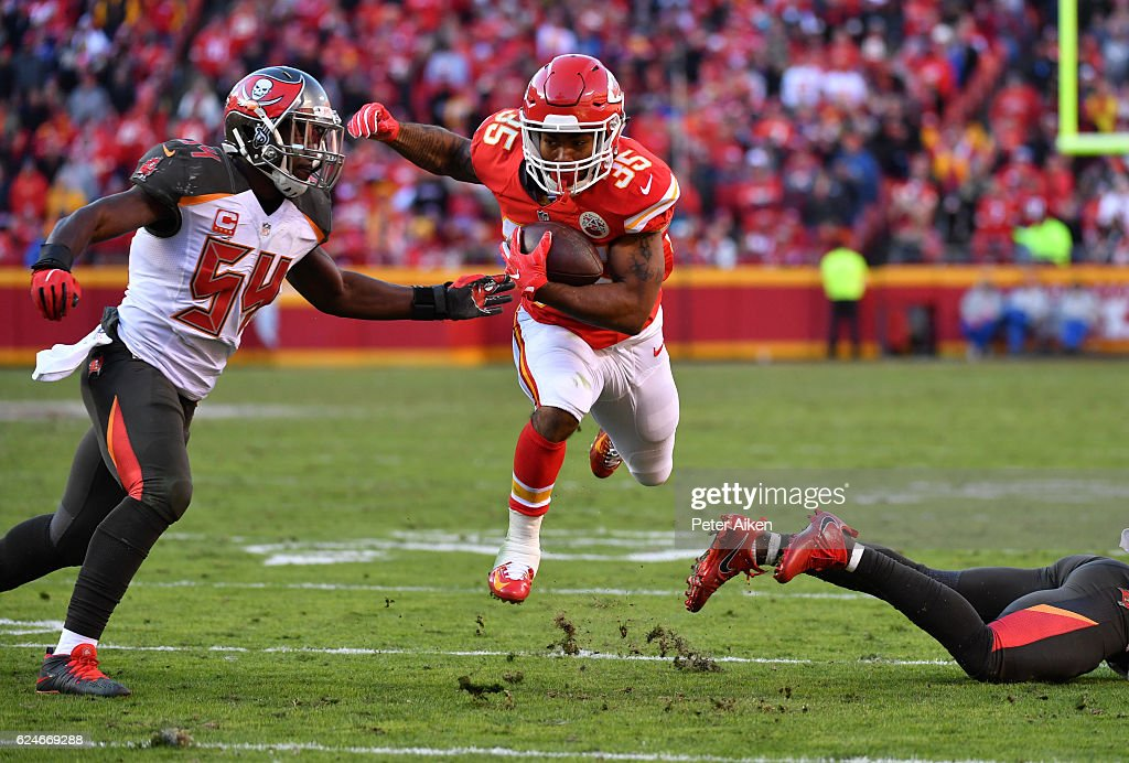 Running back Charcandrick West #35 of the Kansas City Chiefs jumps over a tackle in front of outside linebacker Lavonte David #54 of the Tampa Bay Buccaneers at Arrowhead Stadium during the fourth quarter of the game on November 20, 2016 in Kansas City, Missouri.