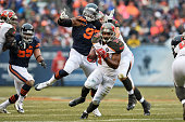 Running back Charles Sims of the Tampa Bay Buccaneers carries the football past defensive end Willie Young of the Chicago Bears in the first quarter...