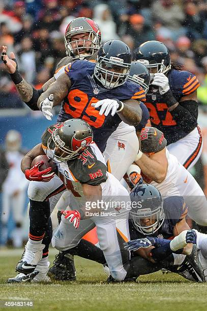 Running back Charles Sims of the Tampa Bay Buccaneers carries the ball ahead of defensive tackle Ego Ferguson of the Chicago Bears in the second...