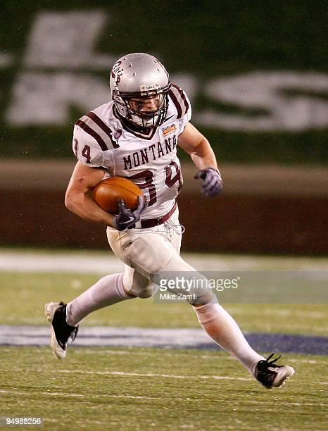 Running back Chase Reynolds of the Montana Grizzlies runs with the ball during the NCAA FCS Championship game against the Villanova Wildcats at...