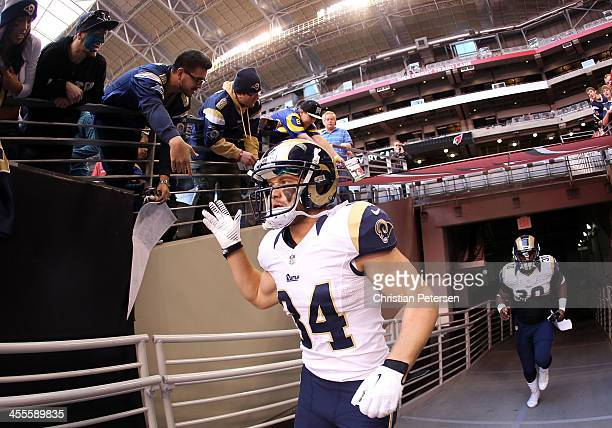 Running back Chase Reynolds of the St Louis Rams highfives fans before the NFL game against the Arizona Cardinals at the University of Phoenix...