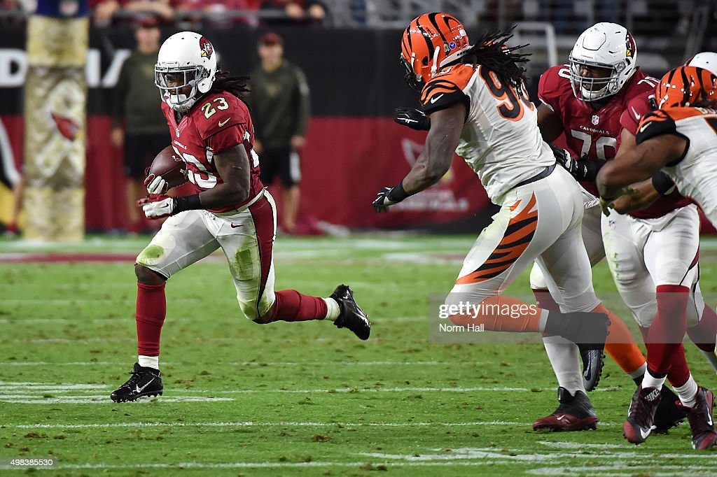 Running back Chris Johnson of the Arizona Cardinals runs past defensive end Will Clarke of the Cincinnati Bengals during the second half of the NFL...