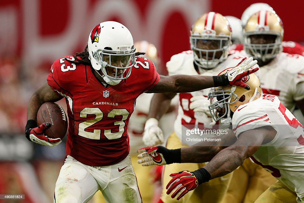 Running back Chris Johnson of the Arizona Cardinals rushes the football past inside linebacker NaVorro Bowman of the San Francisco 49ers during the...