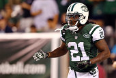 Running back Chris Johnson of the New York Jets reacts against the Indianapolis Colts during a preseason game at MetLife Stadium on August 7 2014 in...