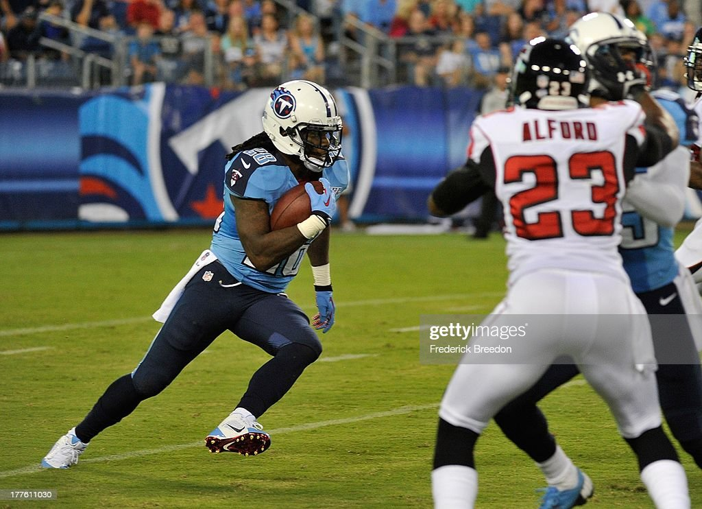 Running back <a gi-track='captionPersonalityLinkClicked' href=/galleries/search?phrase=Chris+Johnson+-+American+Football+Running+Back&family=editorial&specificpeople=211438 ng-click='$event.stopPropagation()'>Chris Johnson</a> #28 of the Tennessee Titans rushes against the Atlanta Falcons at LP Field on August 24, 2013 in Nashville, Tennessee.