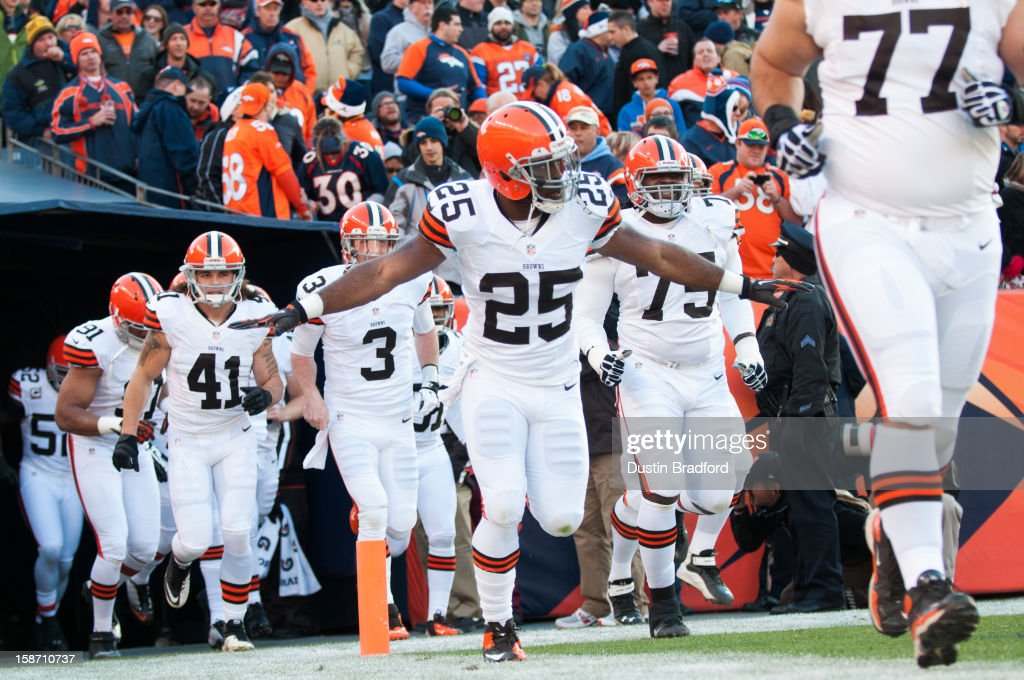Running back Chris Ogbonnaya #25 of the Cleveland Browns runs out of the tunnel with his arms outstretched before a game against the Denver Broncos at Sports Authority Field at Mile High on December 23, 2012 in Denver, Colorado. The Broncos defeated the Browns 34-12.