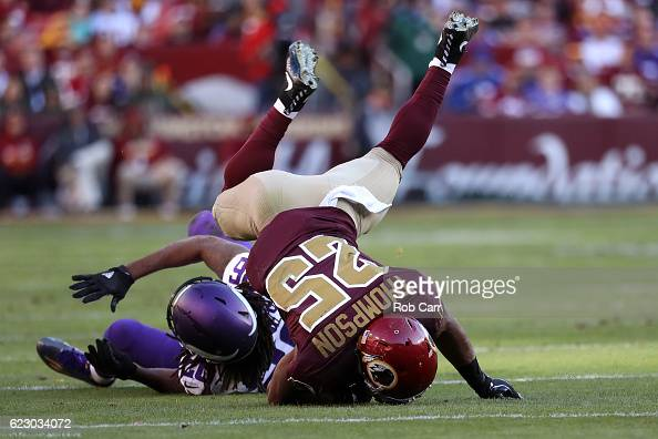 Running back Chris Thompson of the Washington Redskins is tackled by defensive tackle Tom Johnson of the Minnesota Vikings in the fourth quarter at...