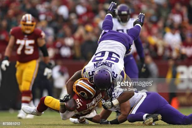 Running back Chris Thompson of the Washington Redskins is tackled by defensive tackle Tom Johnson of the Minnesota Vikings during the fourth quarter...