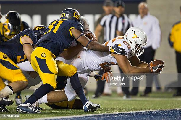 Running back Chris Warren III of the Texas Longhorns dives for the endzone to score a touchdown against the California Golden Bears in the first...