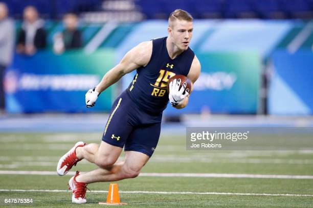 Running back Christian McCaffrey of Stanford carries the ball during a drill on day three of the NFL Combine at Lucas Oil Stadium on March 3 2017 in...