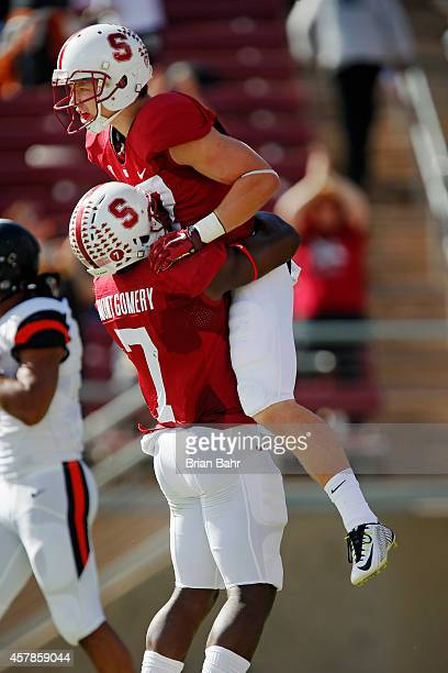 Running back Christian McCaffrey of the Stanford Cardinal gets a lift from wide receiver Ty Montgomery after scorinig on a 42yard touchdown catch...
