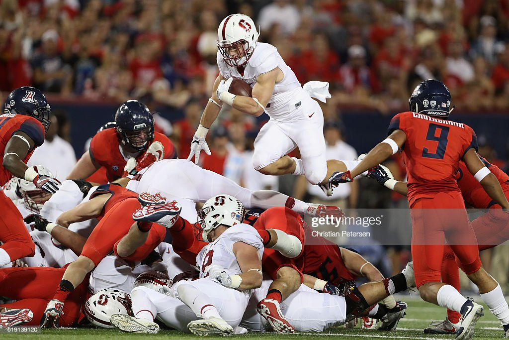 Running back Christian McCaffrey #5 of the Stanford Cardinal leaps with the football as he rushes against the Arizona Wildcats during the second quarter of the college football game at Arizona Stadium on October 29, 2016 in Tucson, Arizona.