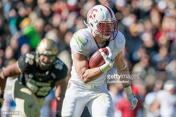 Running back Christian McCaffrey of the Stanford Cardinal rushes against the Colorado Buffaloes during a game at Folsom Field on November 7 2015 in...