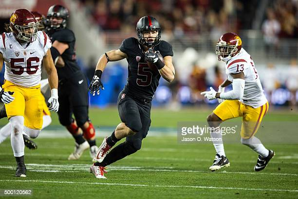 Running back Christian McCaffrey of the Stanford Cardinal rushes up field against the USC Trojans during the first quarter of the Pac12 Championship...