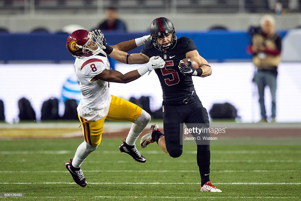 Running back Christian McCaffrey of the Stanford Cardinal stiff arms cornerback Iman Marshall of the USC Trojans on a kick return during the first...