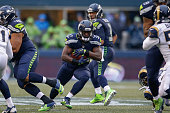 Running back Christine Michael of the Seattle Seahawks rushes against the St Louis Rams at CenturyLink Field on December 27 2015 in Seattle Washington
