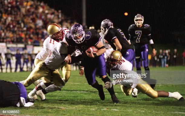 Running back Chuck Moore of Mount Union College makes his way into the endzone on a 3yard touchdown run against Bridgewater College during the...