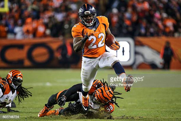 Running back CJ Anderson of the Denver Broncos breaks away from a tackle attempt by middle linebacker Rey Maualuga of the Cincinnati Bengals as he...