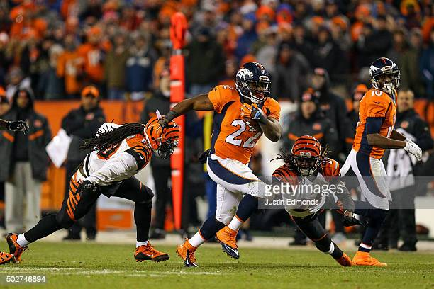 Running back CJ Anderson of the Denver Broncos breaks away from tackle attempts by free safety Reggie Nelson and cornerback Adam Jones of the...