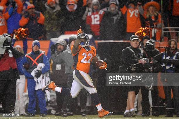 Running back CJ Anderson of the Denver Broncos carries the ball for an overtime touchdown to defeat the New England Patriots 3024 at Sports Authority...