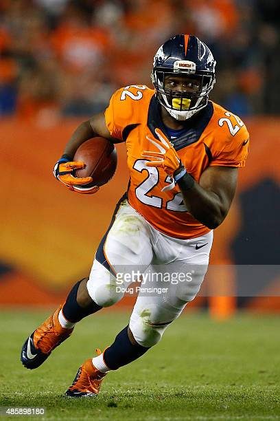 Running back CJ Anderson of the Denver Broncos carries the ball against the San Francisco 49ers during preseason action at Sports Authority Field at...