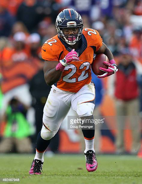 Running back CJ Anderson of the Denver Broncos carries the ball against the Minnesota Vikings at Sports Authority Field at Mile High on October 4...