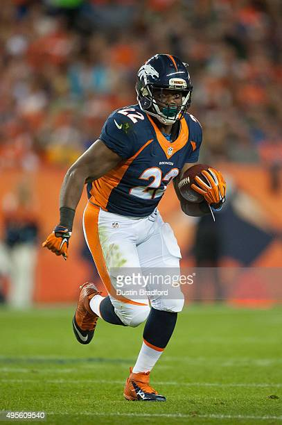 Running back CJ Anderson of the Denver Broncos carries the ball against the Green Bay Packers at Sports Authority Field at Mile High on November 1...