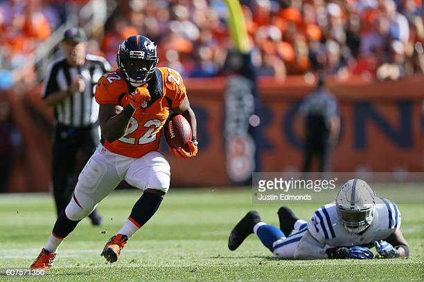 Running back CJ Anderson of the Denver Broncos catches a ball and breaks the tackle of inside linebacker Sio Moore of the Indianapolis Colts for a...