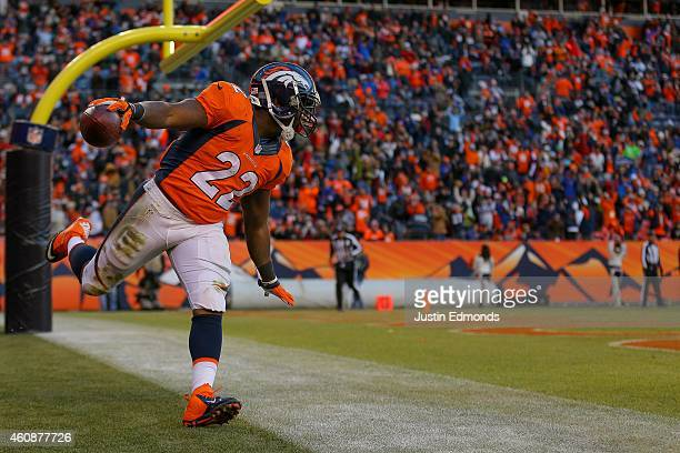 Running back CJ Anderson of the Denver Broncos celebrates a third quarter rushing touchdown against the Oakland Raiders at Sports Authority Field at...