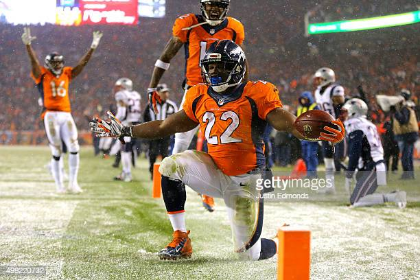 Running back CJ Anderson of the Denver Broncos celebrates after scoring a fourth quarter touchdown against the New England Patriots at Sports...