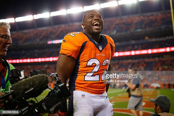 Running back CJ Anderson of the Denver Broncos celebrates the 2120 win over the Carolina Panthers at Sports Authority Field Field at Mile High on...