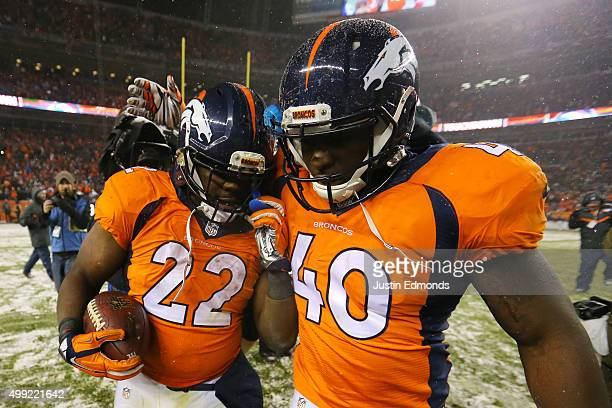 Running back CJ Anderson of the Denver Broncos celebrates with running back Juwan Thompson of the Denver Broncos after scoring an overtime touchdown...