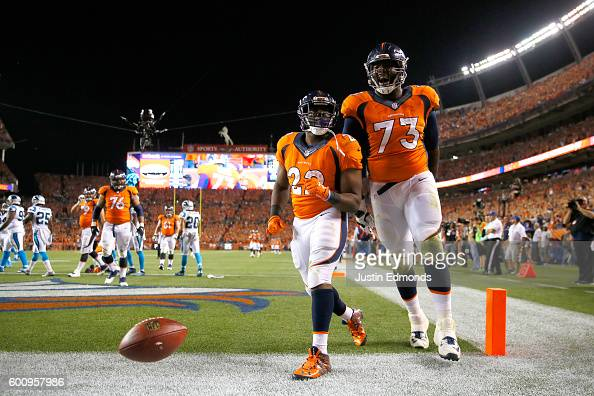 Running back CJ Anderson of the Denver Broncos celebrates with offensive tackle Russell Okung after Anderson scores on a 25yard reception in the...