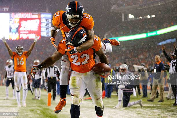 Running back CJ Anderson of the Denver Broncos celebrates with wide receiver Andre Caldwell of the Denver Broncos after scoring a fourth quarter...