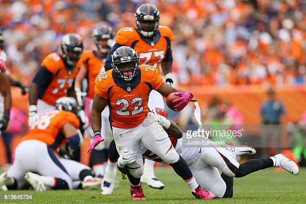 Running back CJ Anderson of the Denver Broncos is tackled in the second half at Sports Authority Field at Mile High on October 9 2016 in Denver...