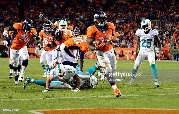 Running back CJ Anderson of the Denver Broncos runs in a touchdown during the fourth quarter resulting in a Broncos 31 to Miami 28 score The Denver...