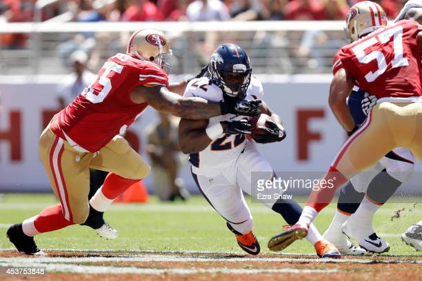 Running back CJ Anderson of the Denver Broncos runs past outside linebacker Ahmad Brooks of the San Francisco 49ers during a preseason game at Levi's...