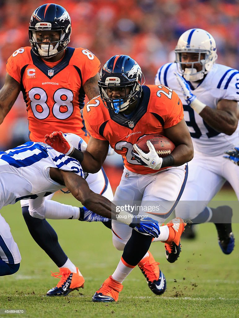 Running back C.J. Anderson #22 of the Denver Broncos runs with the ball as free safety <a gi-track='captionPersonalityLinkClicked' href=/galleries/search?phrase=Darius+Butler&family=editorial&specificpeople=3967703 ng-click='$event.stopPropagation()'>Darius Butler</a> #20 of the Indianapolis Colts attempts to make the tackel at Sports Authority Field at Mile High on September 7, 2014 in Denver, Colorado.